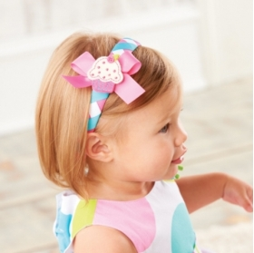 3-piece party headband comes with interchangeable embroidered felt snaps: ice cream cone, cupcake and balloons.