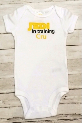 "Layette with yellow Applique jedi , ""in training"" phrase and Name cru"