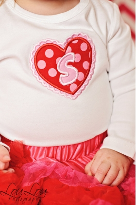 Applique Heart with Initial design.  Fabric red and pink polka dot